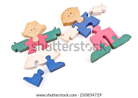 Colorful wooden girl and boy puzzle pieces isolated on white - stock photo