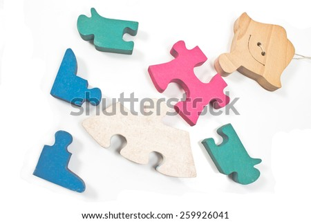 Colorful wooden girl puzzle pieces isolated on white