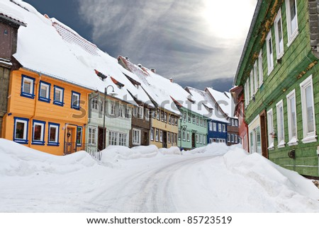 colorful wooden houses snowed in Sankt Andreasberg, Harz Germany - stock photo
