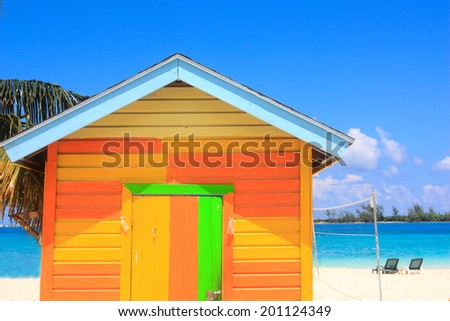 colorful wooden hut on the beach in the caribbean
