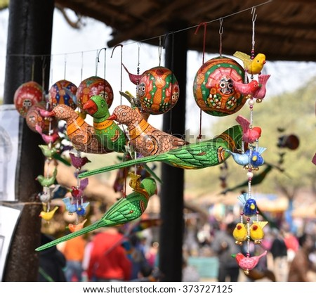 Colorful wooden made parrots and other small and cute birds - stock photo