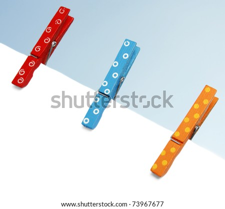 Colorful wooden pegs on a clothes line