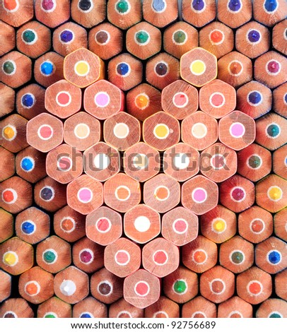 Colorful wooden pencil pattern arrange in heart shape