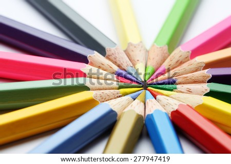 Colorful wooden pencils art composition on white background - stock photo