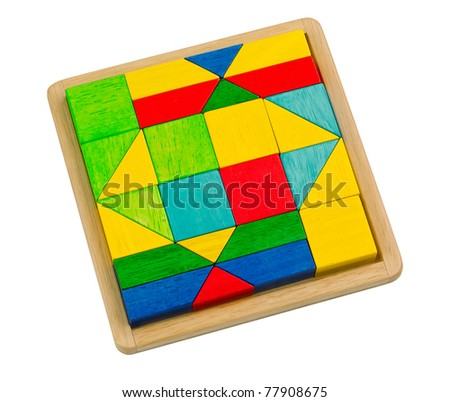 Colorful wooden toy blocks arranges in the tray and ready for kid to creates and build - stock photo