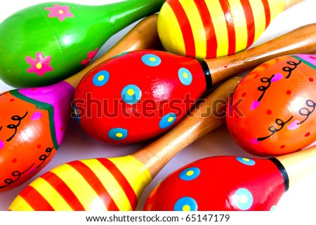 colorful wooden toy maracas music percussion instrument closeup as a background picture - stock photo
