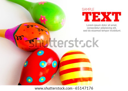 colorful wooden toy maracas music percussion instrument frame with copyspace area isolated on white background - stock photo