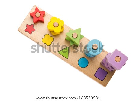 Colorful wooden toys isolated on white background - stock photo