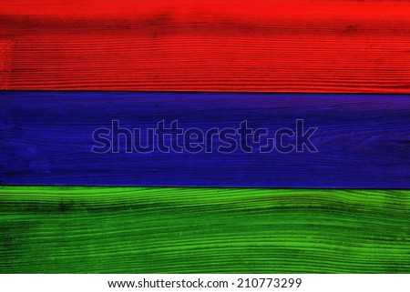 Colorful wooden wall with red, blue and green planks