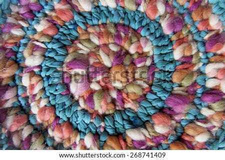 Colorful wool. Abstract multicolor texture background. Handmade crocheted pattern. Image of braided multi colored woollen yarns. Decorative mandala reproduction. - stock photo