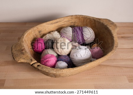 Colorful wool balls in a wooden bowl - stock photo