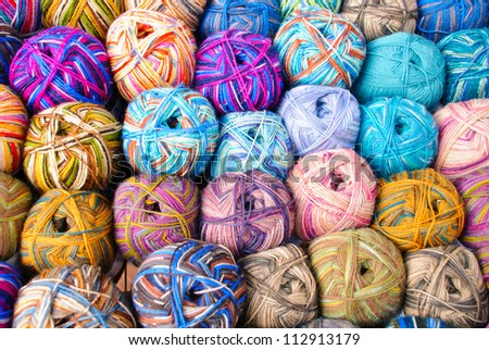 Colorful wool balls next to eachother - stock photo
