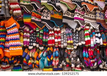 Colorful woolen socks, hats and gloves background - stock photo