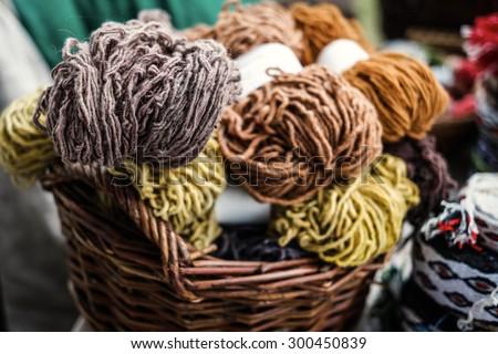colorful woolen yarn in wooden baskets - stock photo