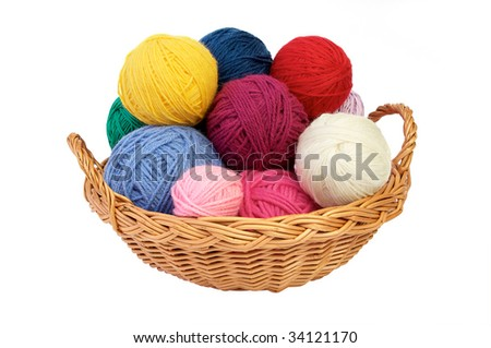Colorful yarn balls in a straw basket isolated on white background - stock photo