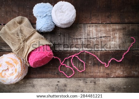 Colorful yarn balls on a wooden background room for copy space  vintage style - stock photo