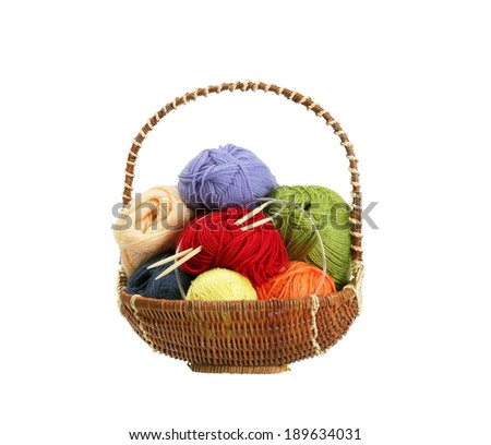 Colorful yarn clews in basket isolated on white - stock photo