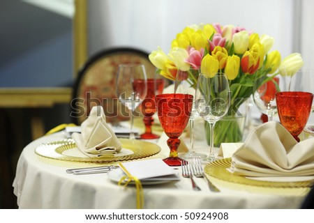 Colorful yellow and red festive table - stock photo