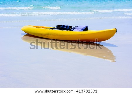 Colorful yellow kayaks on beach , Thailand - stock photo