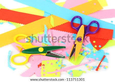 Colorful zigzag scissors with color paper isolated on white - stock photo