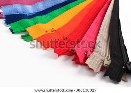 Colorful Zippers in six different colors on white background.