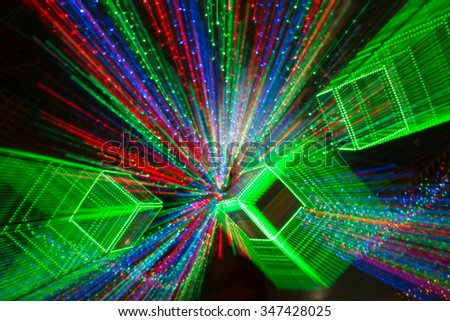 Colorfull background with christmas lights in boken.  Yellow, dark, blue and red light in Bokeh. Defocused. Festive and celebratory background. Disco lights. Laser show - stock photo