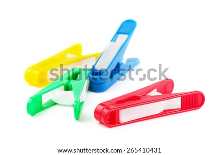 Colorfull clothespin on a white background  - stock photo