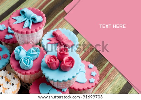 Colorfull cup cake in stack with a place for text  isolated beautiful mat - stock photo