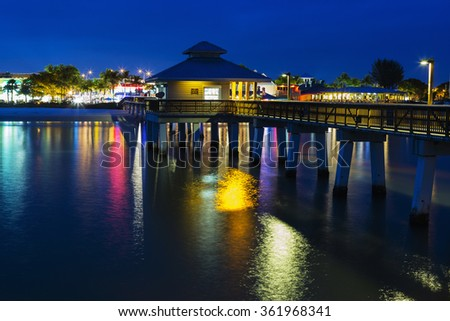Colorfull evening on the pier in Fort Myers Beach, Gulf of Mexico Coast, Florida. - stock photo