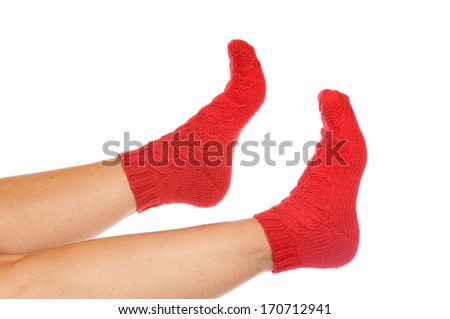 Colorfull, handmade socks in front of a white background - stock photo