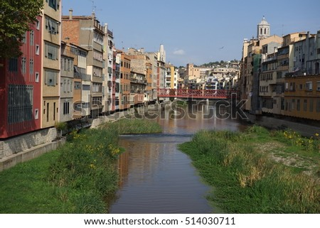 Colorfull houses of Girona with Onyar river and Eiffel bridge. Catalonia