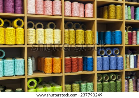 Colorfull sewing threads in a stock - stock photo
