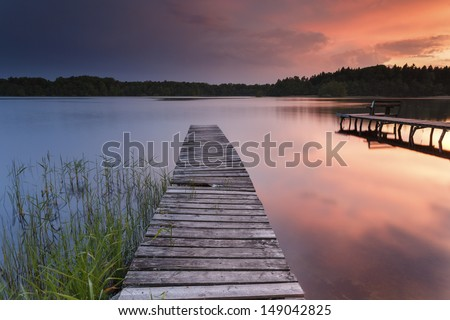 Colorfull sunset on Bobi?cino lake in north Poland. Pomerania district. - stock photo