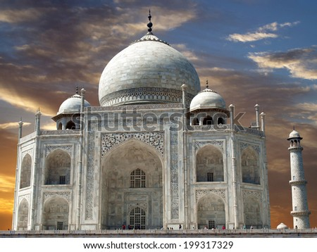 colorfull sunset with orange and blue clouds and view of Taj Mahal, Agra, Uttar Pradesh, India - stock photo