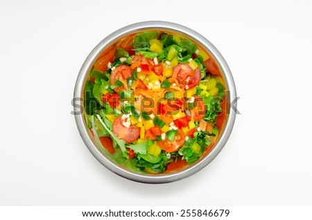 colorfully fresh mixed salad in shiny round bowl isolated on white background - stock photo