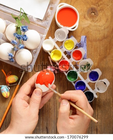 Coloring Easter eggs (hand in the shot)  paint and brushes - stock photo