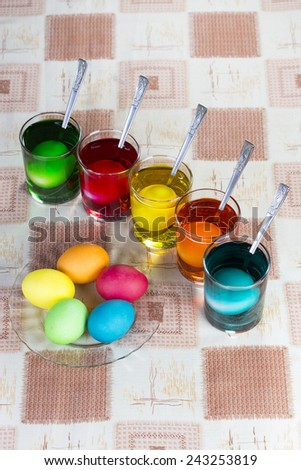 Coloring eggs in bright colors for Easter holiday - stock photo