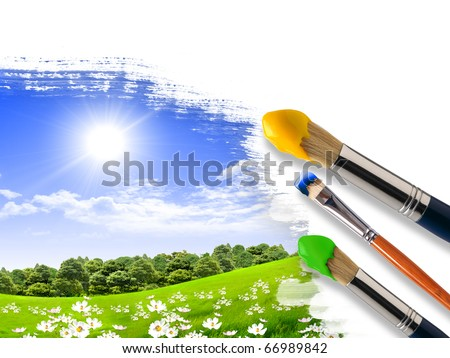 Coloring landscape with blue sky and green grass with a brush. - stock photo