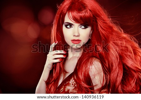 Coloring Red Hair. Fashion Girl Portrait With Long Curly Hair over Holiday Background - stock photo