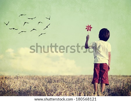 Colorized vintage image of a child in nature - stock photo