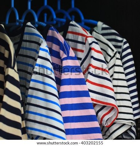 Colors of rainbow. Variety of casual shirts on hangers - stock photo