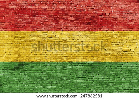Colors of reggae music painted over white brick wall - stock photo