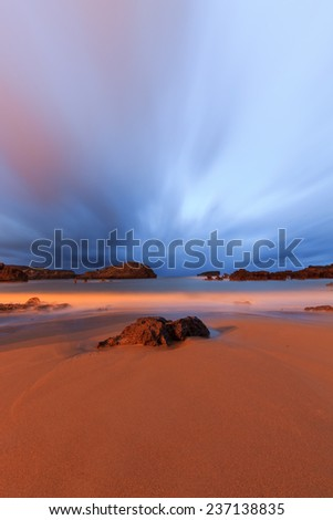 Colors of the sunrise on the beach - stock photo