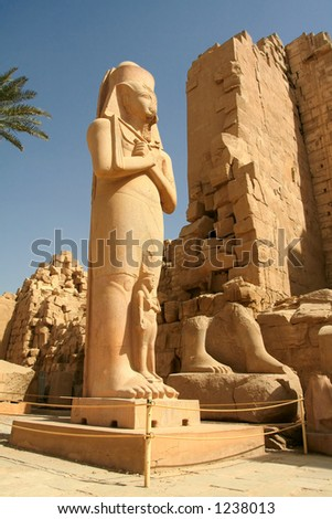 Colossal statue of pharaoh found broken in the court. The royal name carved on his belt mentions Paynedjem (21st Dyn.). However, the original owner of the statue was Ramsses II or an even earlier king - stock photo