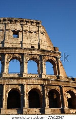 Colosseo and blue sky. - stock photo