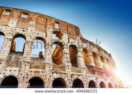Colosseum and  glimpses of sunshine, Rome, Lazio, Italy, Europe Colosseum, roman colosseum, Rome Colosseum, landmark Colosseum, Rome Colosseum  - stock photo