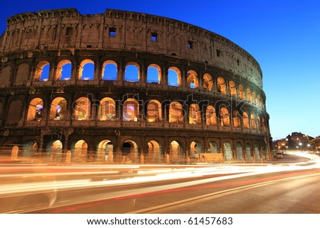 Colosseum and traffic light trails at twilight in Rome - stock photo
