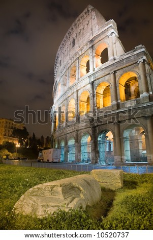 Colosseum arena, night view, vertical frame. Rome, Italy. - stock photo
