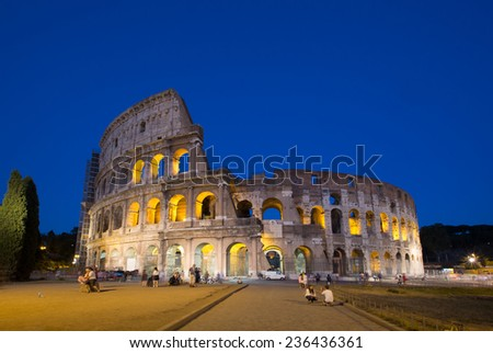 Colosseum (Coliseum) at night in Rome, Italy - stock photo