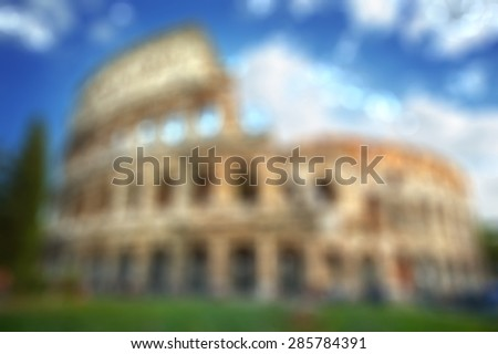 Colosseum in Rome - blurred background with natural bokeh - stock photo